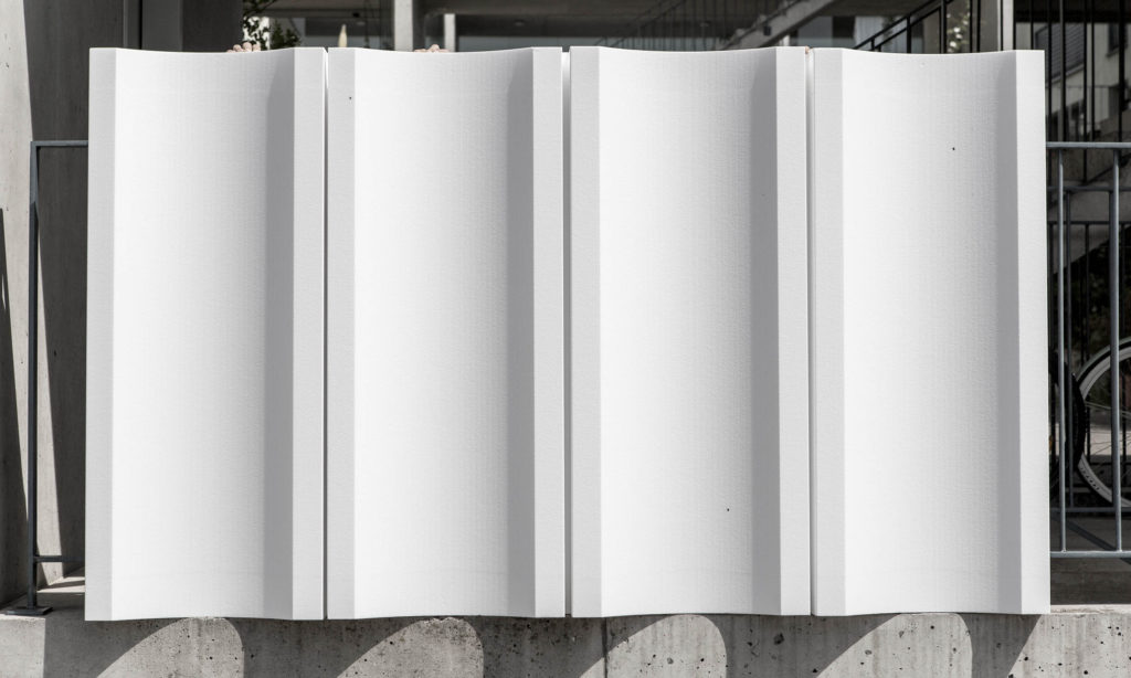 Gesamterneuerung Schulanlage Grossmatt Hergiswil, Fassadenplatten in Styropor